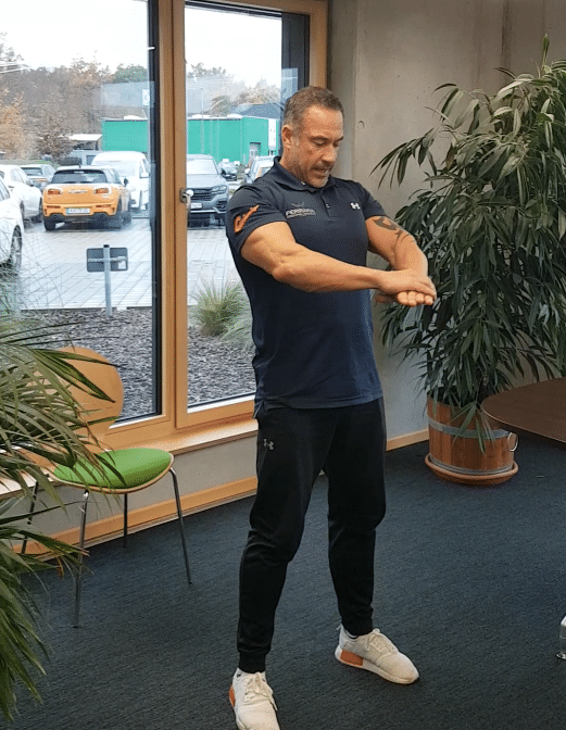Andreas Marcello-Ferrara conducting a digital office workout at the TUP Campus