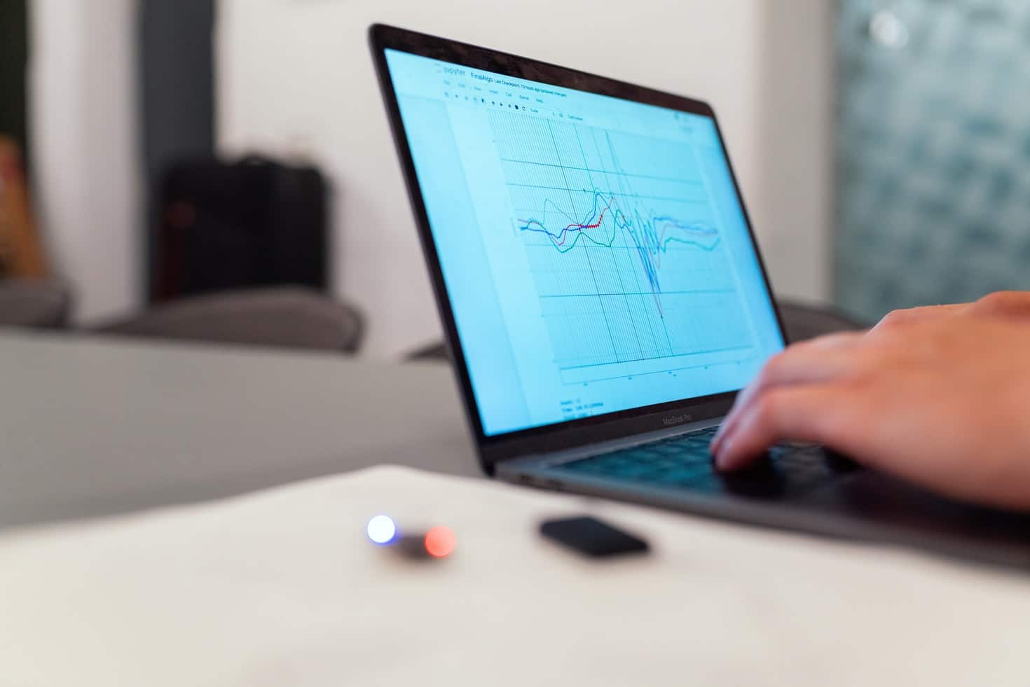 Laptop with graphs. Image source: https://unsplash.com/photos/f4pUuCc3M0g